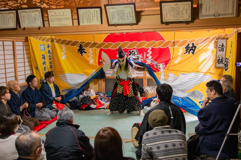 Kagura being done in small home with the local seniors gathered around in Kamaishi City.