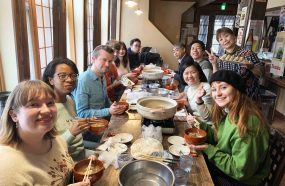group of people gathering on table eating Iwate soup