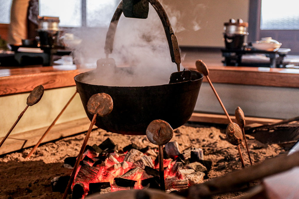 special iwate mochi being heated over a hearth. delicious traditional soup being heated on a hearth.