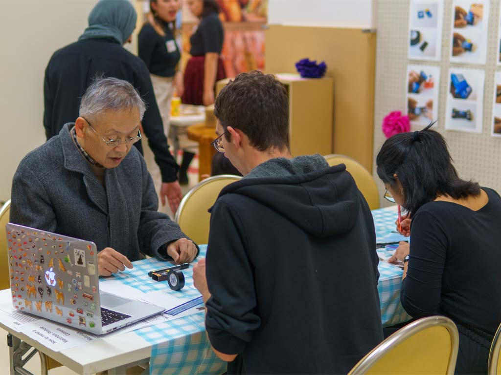 Fukushima Volunteer participating in a craft workshop.